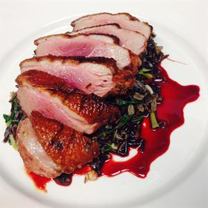 Duck steak with wild rice and cherry jus