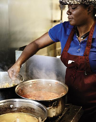 Toyin Takeout's cook prepares egusi