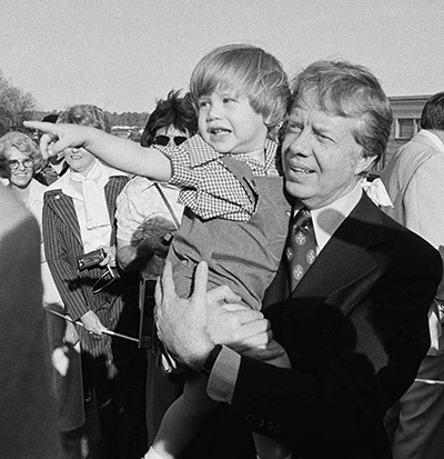 Jason Carter with his grandfather Jimmy, as the then-president arrived in Calhoun for an Easter weekend visit in 1977.