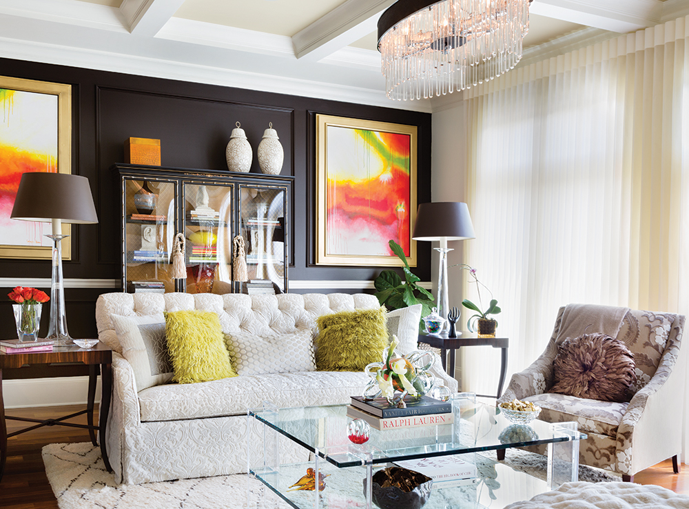 Dark chocolate walls create depth in the living room, while crystal and glass accessories keep the room from becoming too heavy.