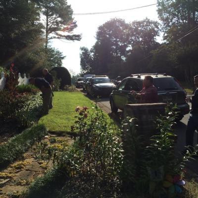 Investigators at McCoy's home.
