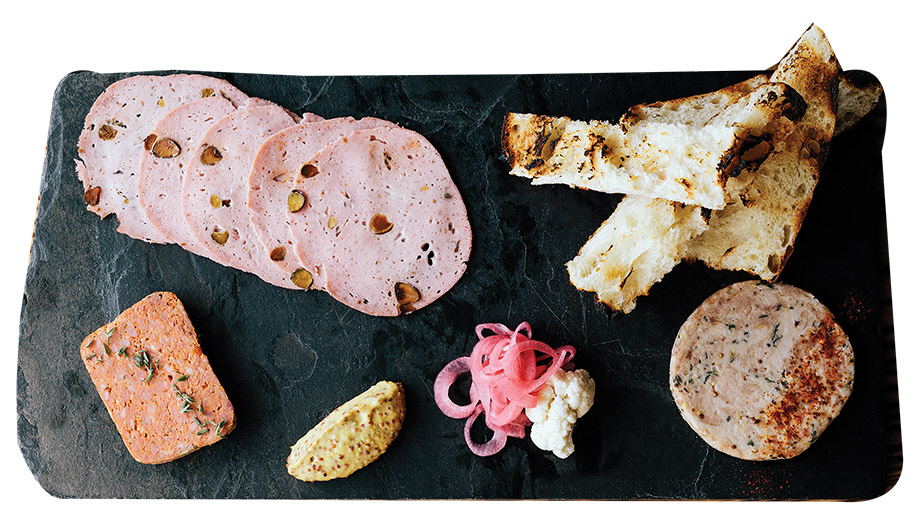 Clockwise from top left: rabbit mortadella studded with pistachios and fatback, grilled house bread, poultry and fine herb rillette, smoked pork terrine