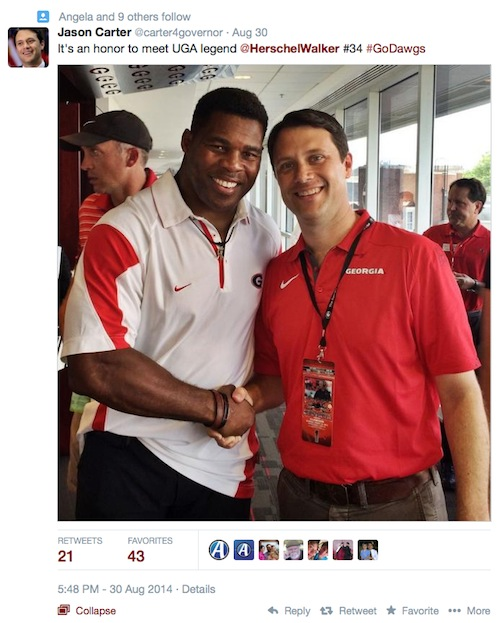 The Carter campaign tweeted this image of the candidate with UGA star Herschel Walker on the opening game of the 2014 season.