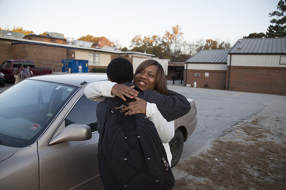 As a state-chartered school, Utopian does not have use of Clayton County's school buses. Twanna Anderson drops off her son Giani on her way to work in the morning and relies on carpools to get him home.