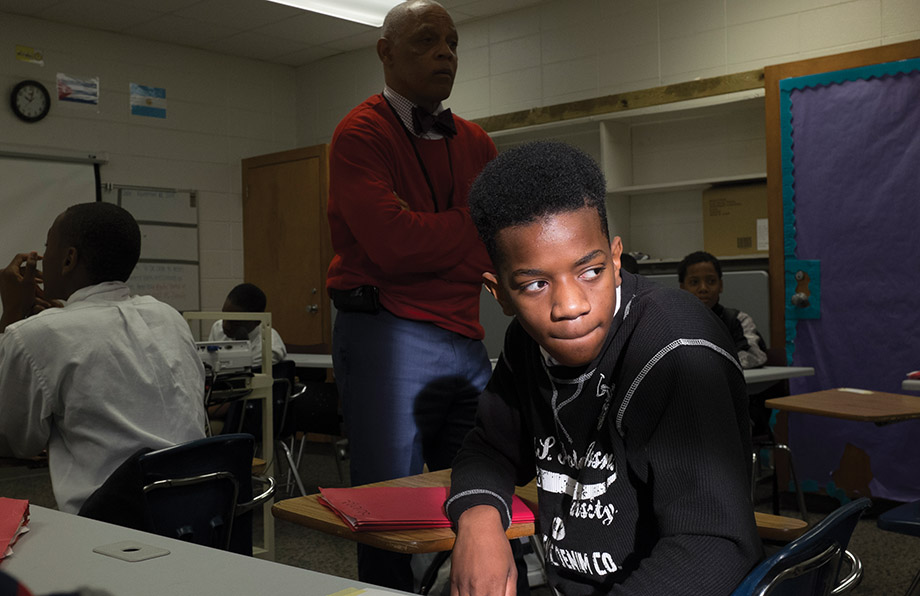"""""""If you don't reach a child by seventh grade, they won't make it to tenth,"""" says Principal Frederick Birkett (in red sweater). Middle school students can be molded, he says, and they are generally eager to learn and like school. """"High school is too late,"""" he says."""