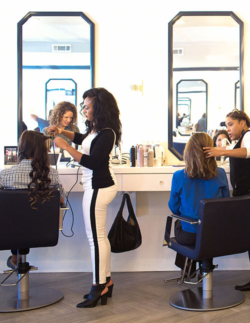 A free head massage and makeup touch-up give GlowDry the edge.