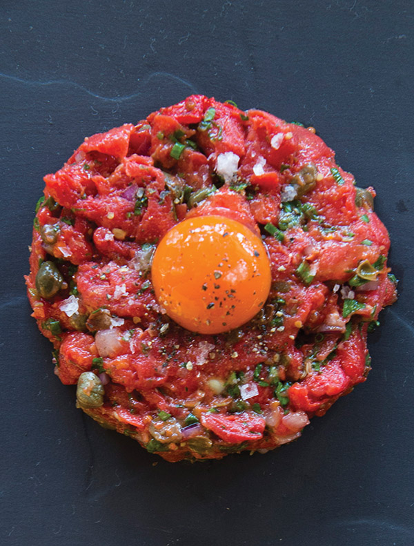 Cured tomato tartare with carrot yolk at Cooks & Soldiers