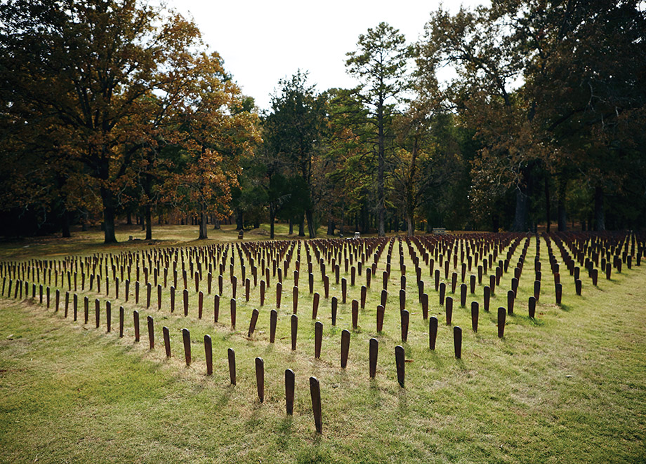 Some 2,000 cast-iron markers at Cedar Lane Cemetery commemorate the 25,000 patients buried on the hospital grounds. The markers, with numbers instead of names, once identified individual graves but were pulled up and tossed into the woods by unknowing prison inmates working as groundskeepers to make mowing easier.