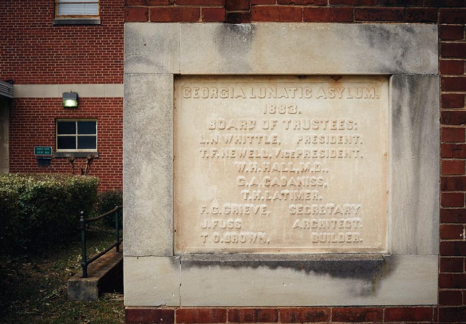 A marble marker commemorates the asylum's origins.