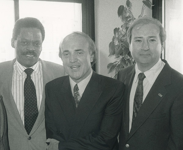 From left to right, Shaw, Arnett, and Holliman