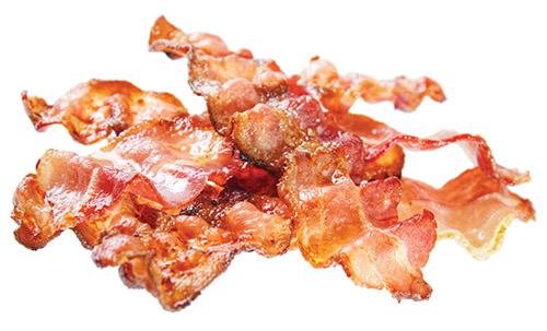 *** Local Caption *** Fried bacon rashers , isolated on white background
