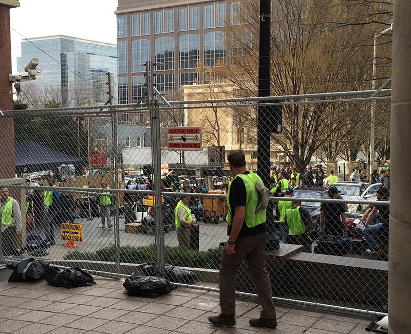 "Crews dress downtown Atlanta as a quarantine zone for filming ""Cordon."""