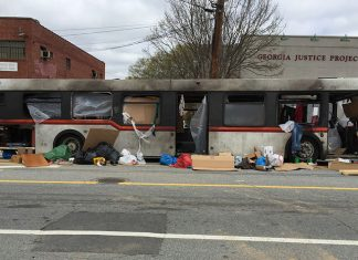 "A burned out bus, part of a set for ""Cordon"" filming in Atlanta on Edgewood Avenue"
