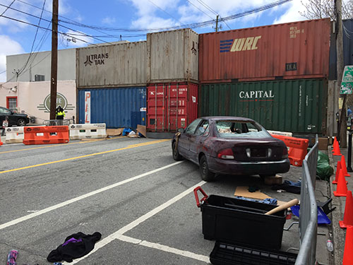 "Shipping containers block Atlanta from the outside world in ""Cordon,"" filming in Atlanta on Edgewood Avenue."
