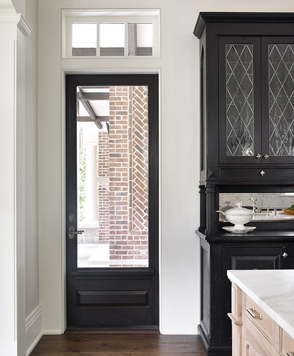 The ebonized china cabinet is built in. Counters are Calcutta marble.