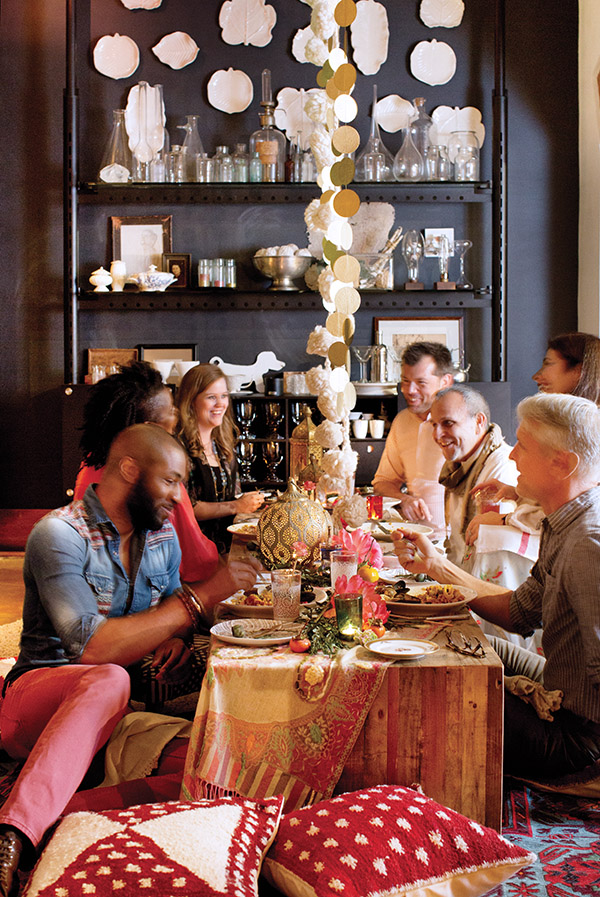 Lining up low coffee tables covered in layers of cloth and imported fabrics, and surrounded by mismatched pillows and poufs, created an exotic setting for the Spanish feast.