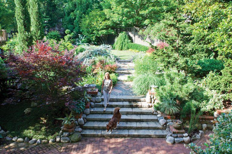 A little smoke and mirrors make this Ansley Park garden a Zen paradise
