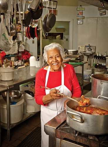 """Leah Chase, the """"Queen of Creole Cuisine"""" checks on the gumbo at Dooky Chase's Restaurant."""