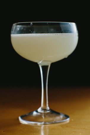White Walker cocktail with dry gin, absinthe, lime, and aperitif blend.
