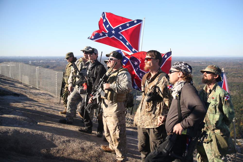 Protesters hold their Confederate flags at a 'Defend Stone Mountain' on November 14, 2015.