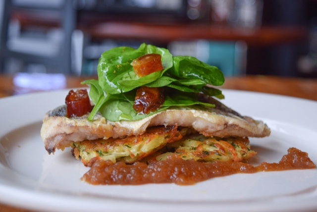 Roasted trout on parsnip potato latkes with date and spinach salad and apple butter