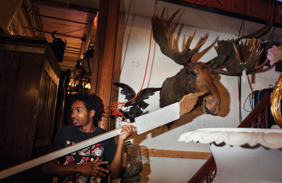 Red Baron employee points to moose.