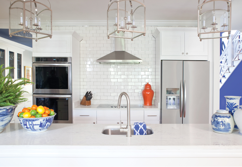 The PKL fellows often design all-white kitchens to let other rooms steal the show, color-wise. Shiny surfaces, such as the tile backsplash, make the room seem bigger.