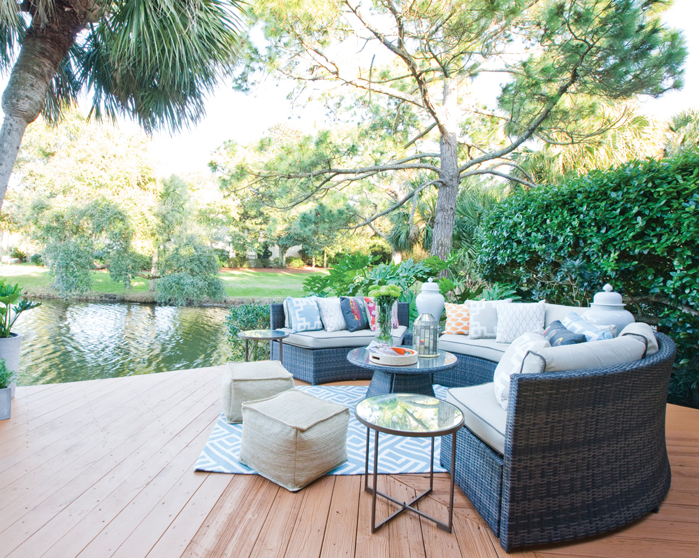 A curvy outdoor sectional gives everyone a view of the peaceful lagoon. An assortment of pillows are from Target.