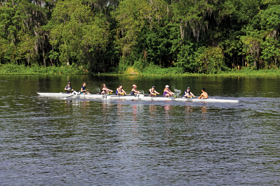 A crew team uses the river as a practice facility.