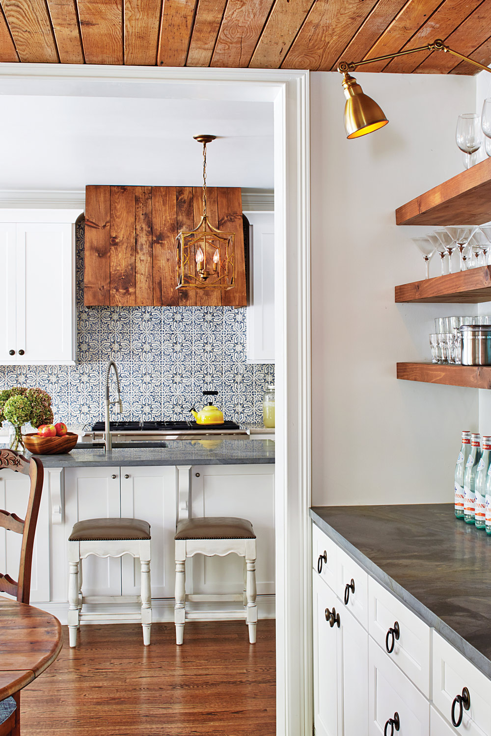 The homeowners splurged on Walker Zanger tile to give the space personality. They saved money by using a simple pine vent hood.