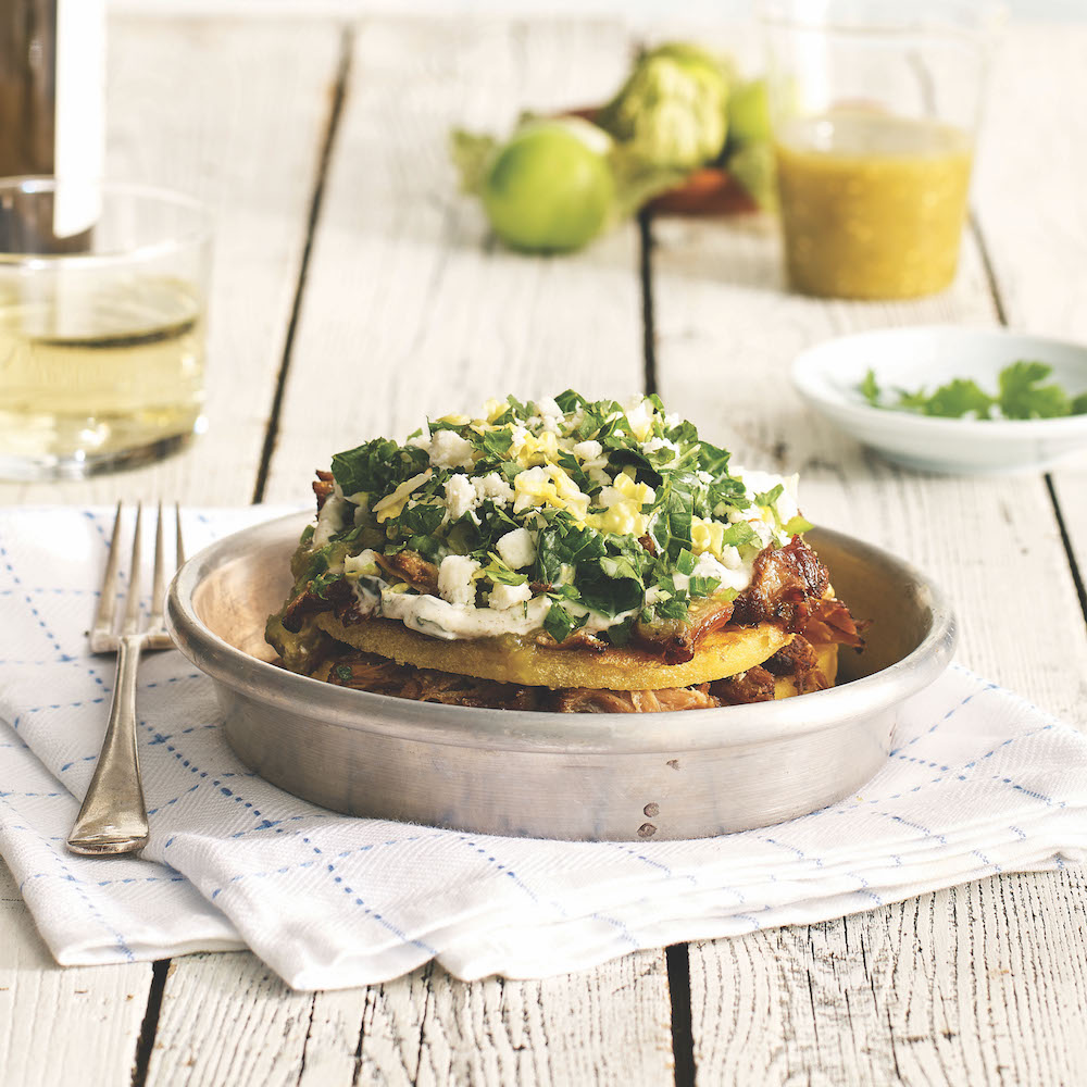 "Schlotsky's Austin Eatery's ""Picante Papusa"": pork carnitas with mozzarella, salsa verde, jalapeños, pineapple, and kale coleslaw."