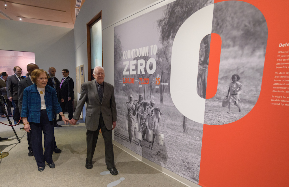 "President Carter and his wife Rosalyn Carter enter the ""Countdown to Zero"" exhibition at the Carter Presidential Library and Museum."