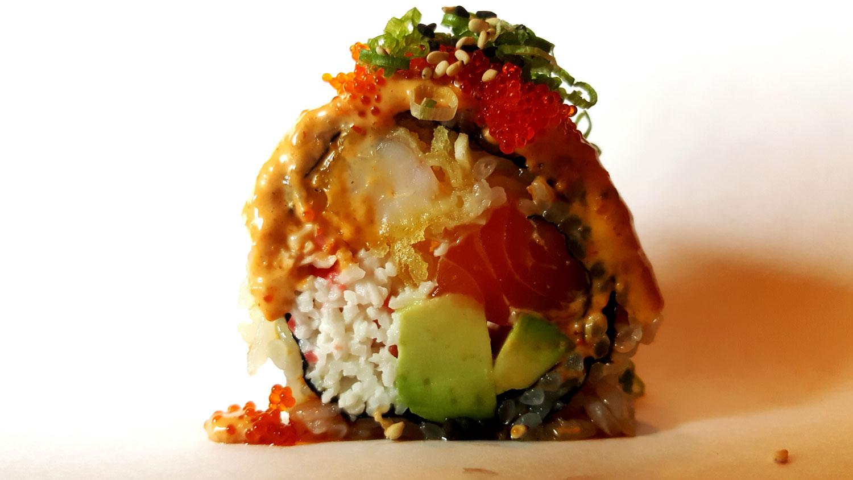 Island Roll (salmon, lemon, shrimp tempura, cucumber, avocado, eel sauce, spicy mayo, fish roe)
