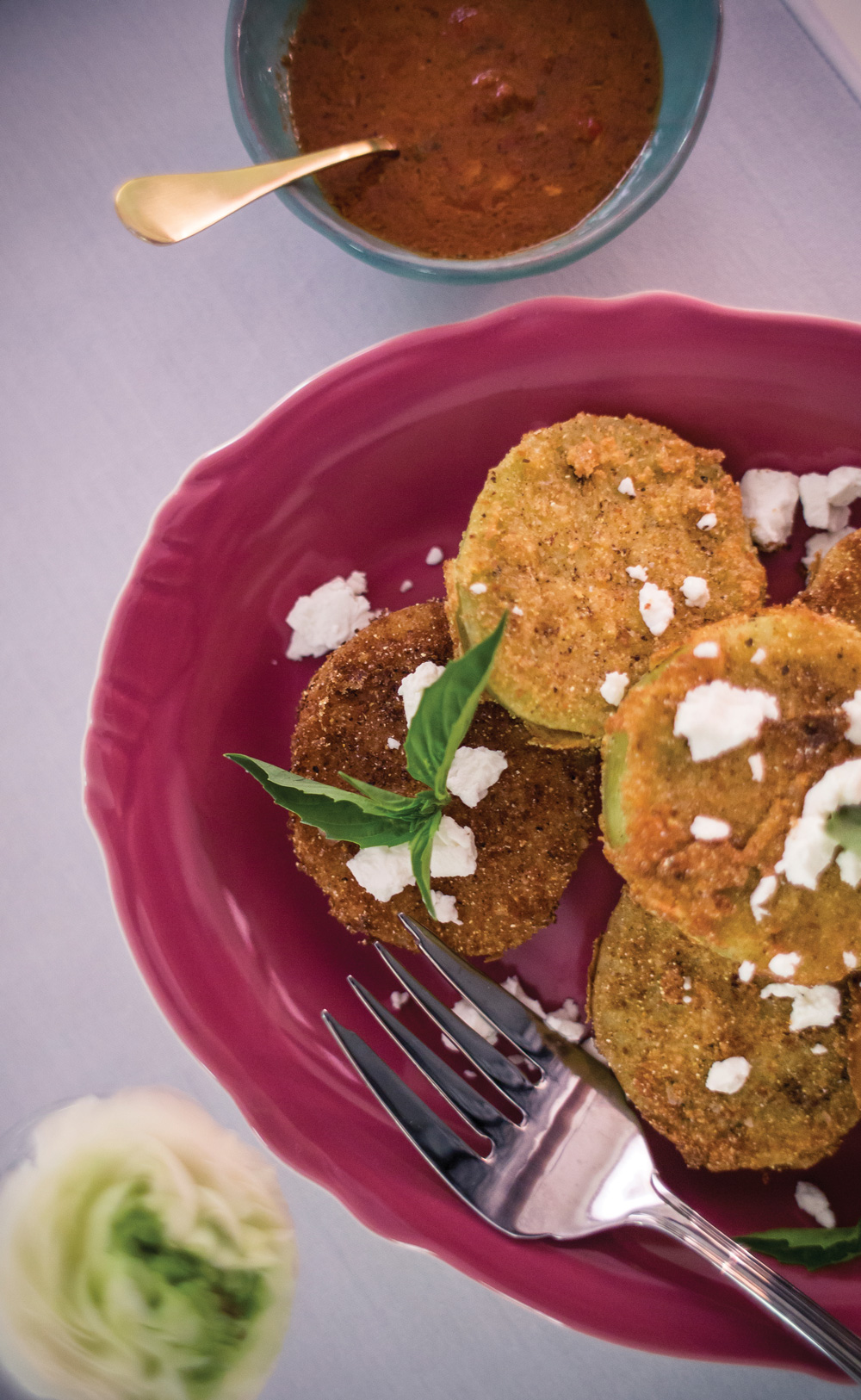 Fried green tomatoes with goat cheese and red pepper coulis