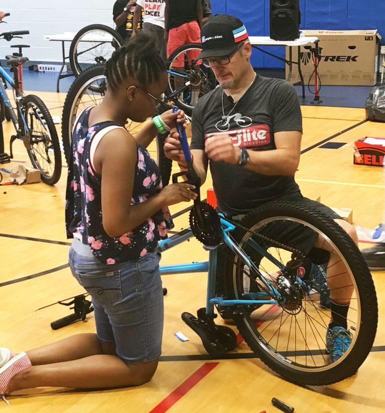 Atlanta Falcons host a bicycle build day at the East Lake YMCA