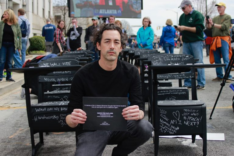 With 14 empty school desks, Atlanta artist Joseph Guay gave March for Our Lives protesters another way to speak out
