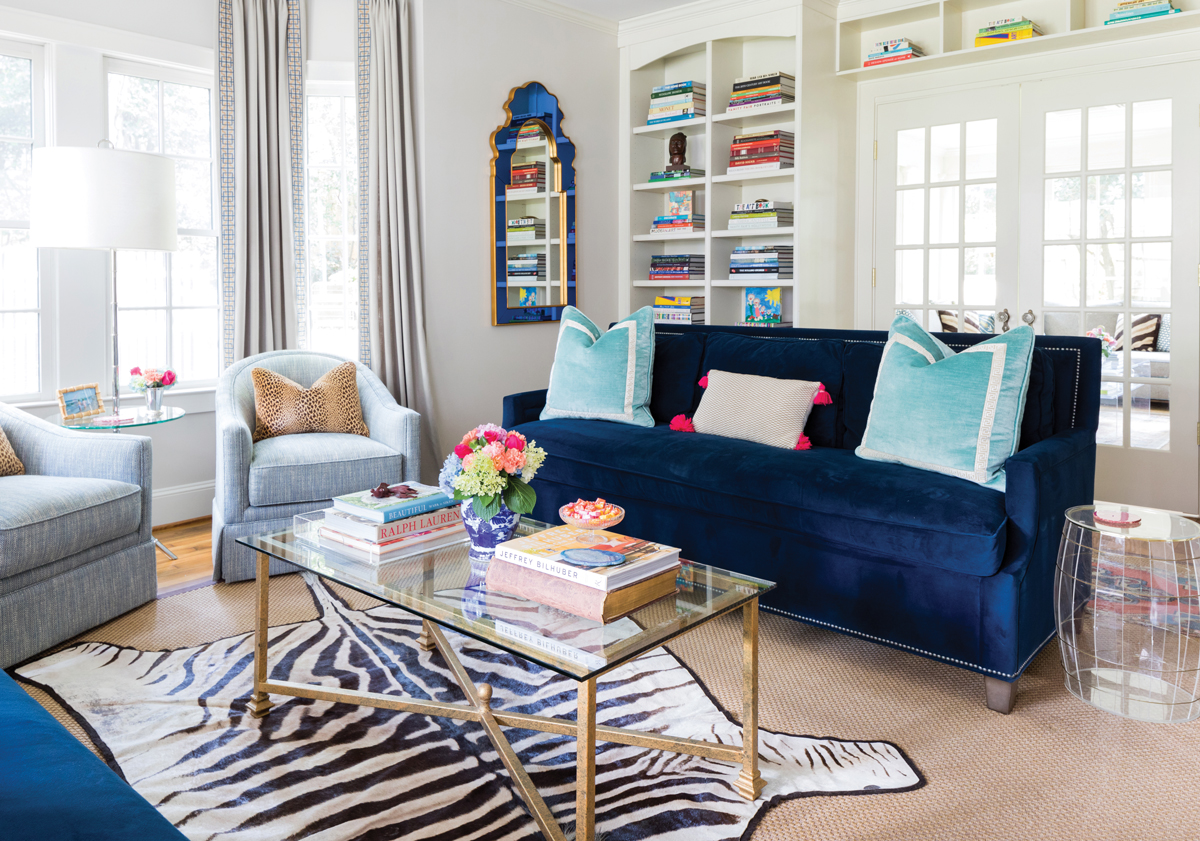 Art and color obviously play an important role in our home says the decorator navy aquamarine and light blue fill the living room which also reflects