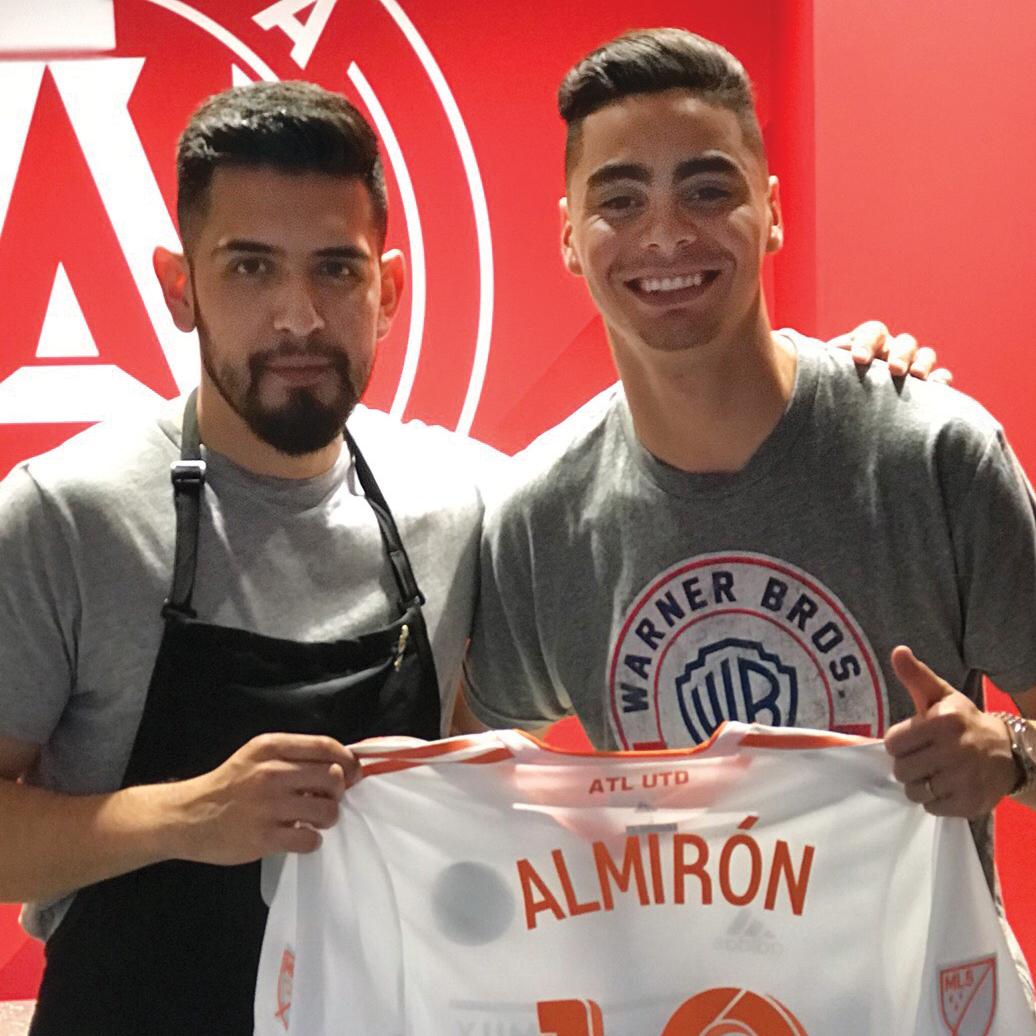 Zuñiga with Miguel Almirón