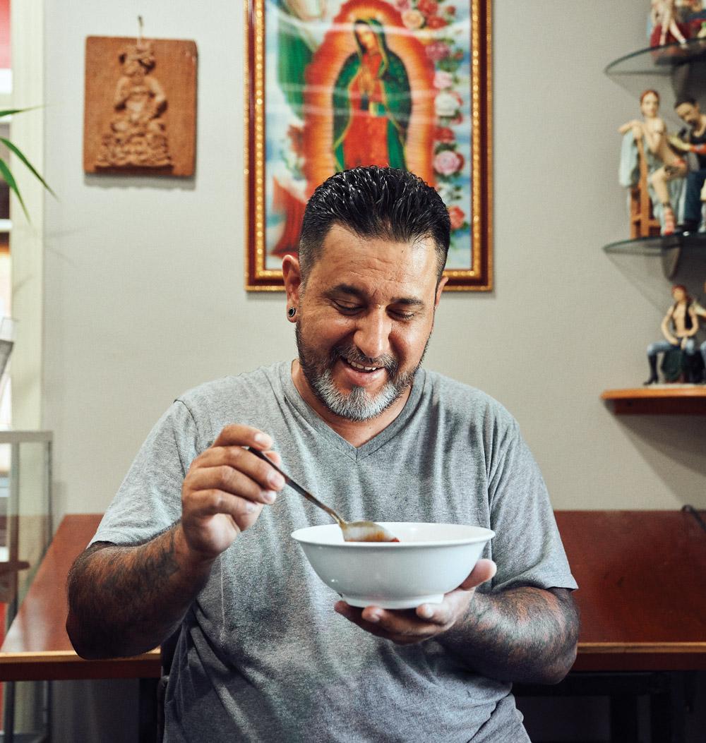 Daniel Tapia eats menudo