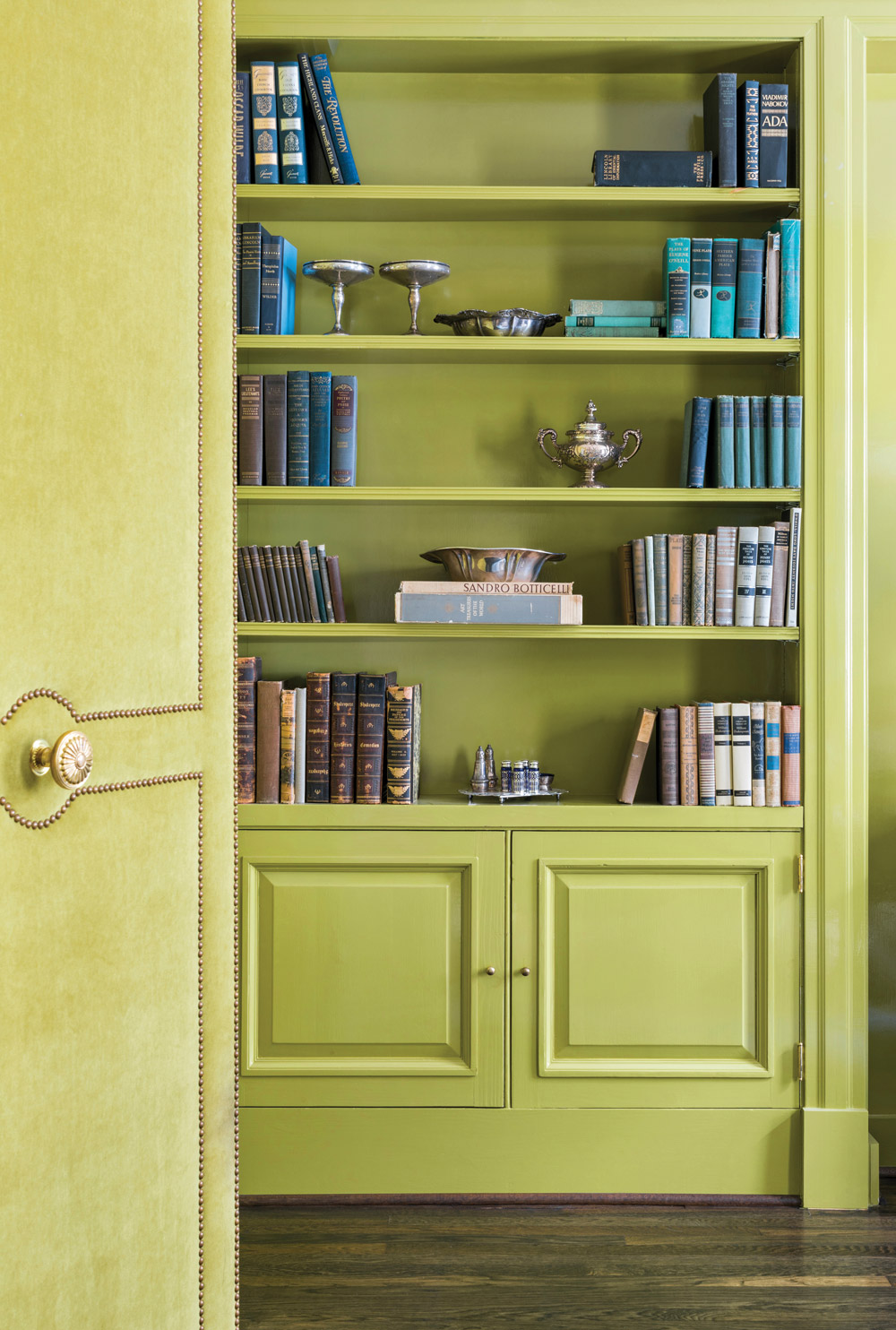 A lime green door upholstered in velvet
