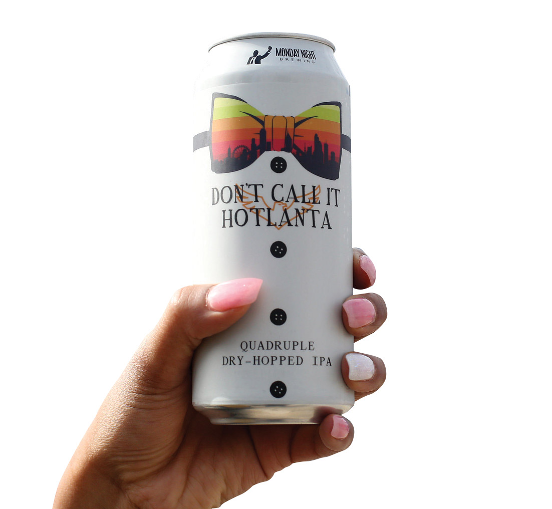 Someone holding a can of Don't Call It Hotlanta by Monday Brewing