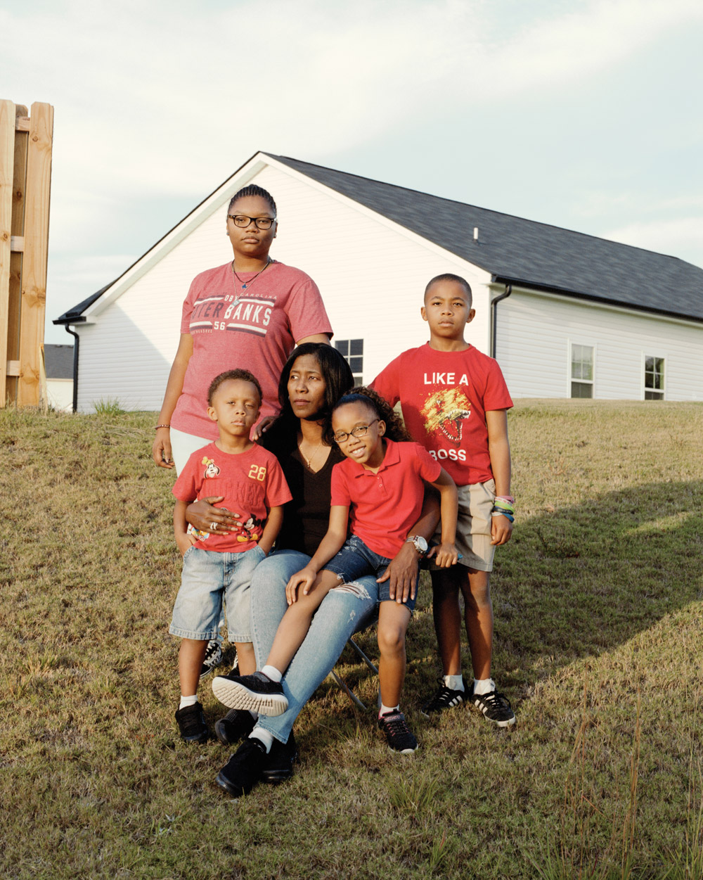 Demetress Williams surrounded by four of her foster children