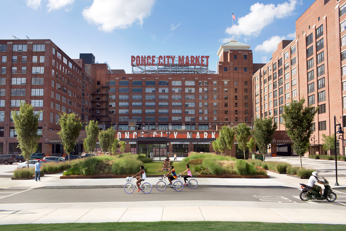 Exterior of Ponce City Market with people biking by