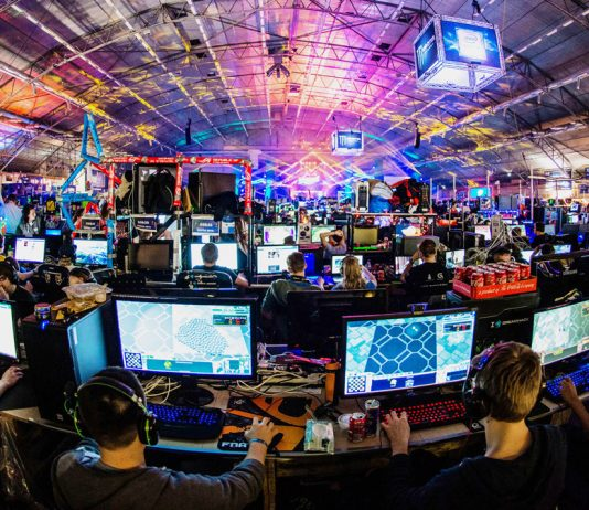 A room filled with people playing computer games