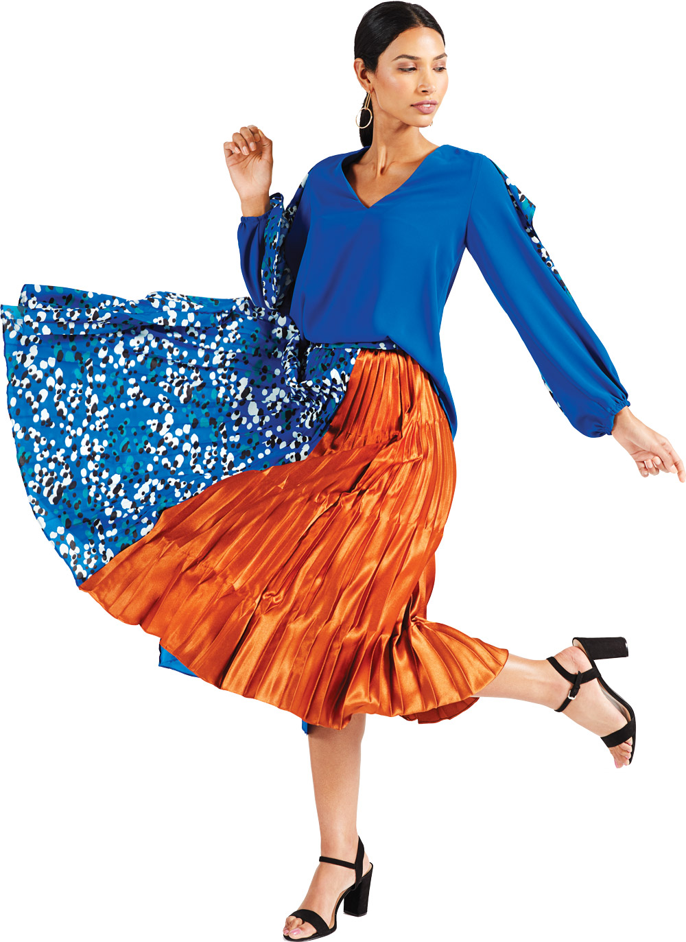 A model wearing a flowing blue and orange skirt and blue blouse