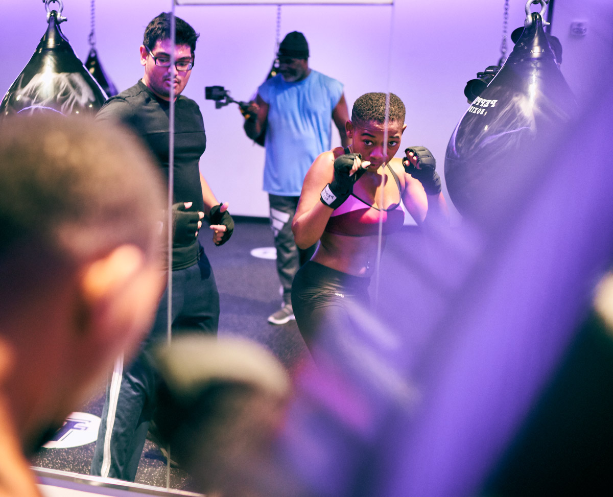 A boxer squares up in a mirror
