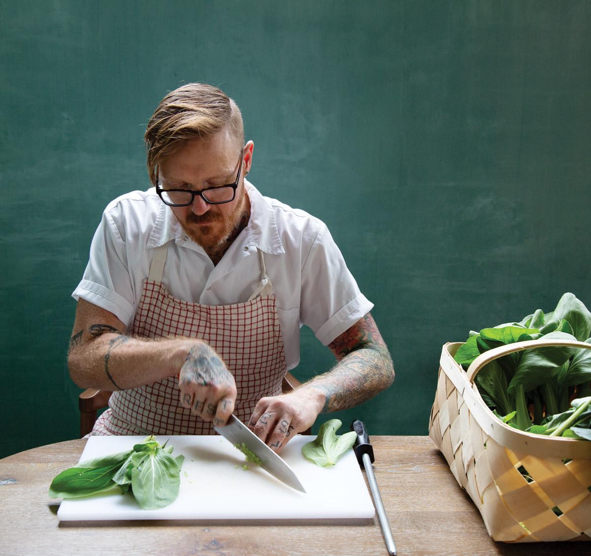 Redbird chef Zeb Stevenson cutting vegetables