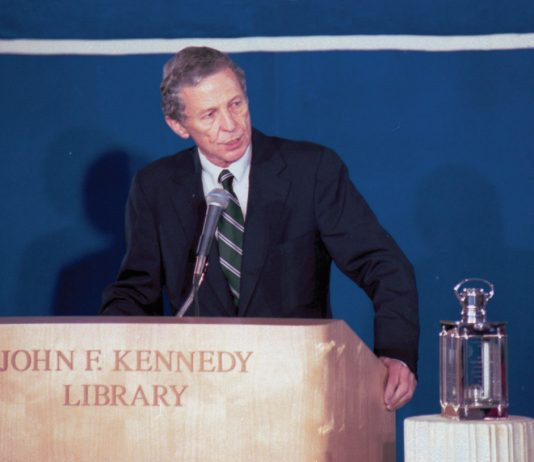 Charles Weltner standing at a John F. Kennedy Library podium