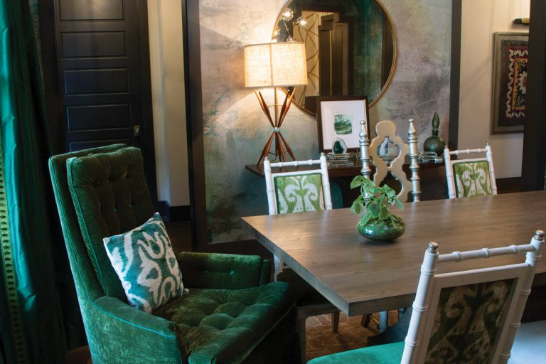 A designer's cozy green dining room is perfect for holiday entertaining