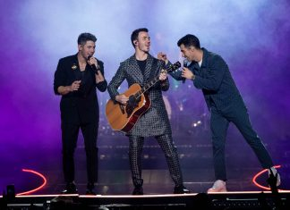 Nick Jonas, Kevin Jonas, and Joe Jonas perform at The Forum on December 14, 2019 in Inglewood, California